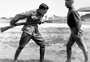 Training Camp Activities. Bayonet fighting instruction by an English Sgt. Major, Camp Dick, Tex. Ca. 1917-18. (War Dept.) Exact Date Shot Unknown NARA FILE #: 165-WW-146B-16 WAR & CONFLICT BOOK #: 449